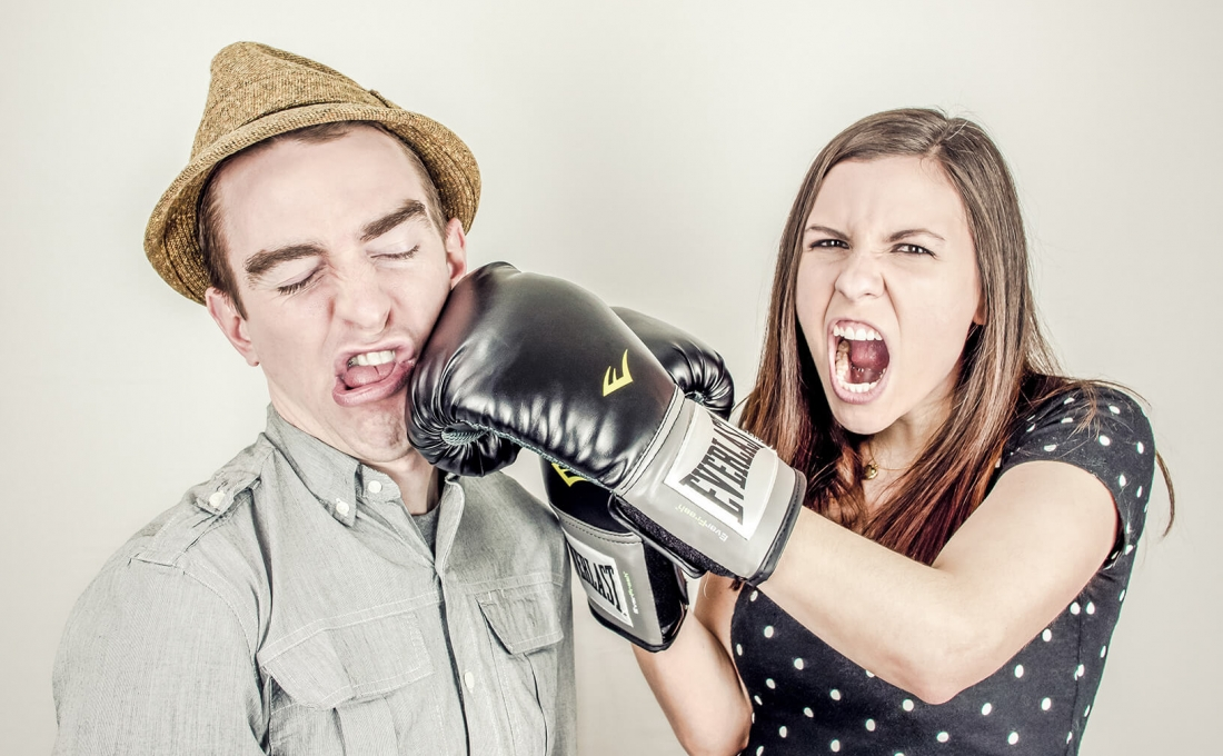 Two people fighting. They mean it! | 5 reasons you should stop fighting over your nonprofit's home page